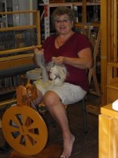 At the Guild's monthly Spin & Chat, a spinner shows off her inventory of fleece.