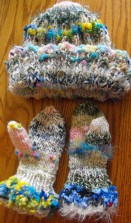 These hand-knitted items include yarn that is handspun from the spinner's alpacas.