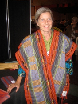 After being awarded Most Interesting Handwoven Piece at the 2010 Five Counties competition, a Guild member wears her winning table runner.