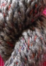 This handspun wool is plied with a variegated fine yarn.