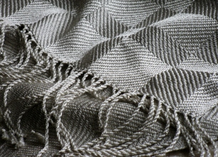 This silk shawl is woven in twill blocks.