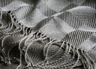 This silk shawl is woven in twill blocks.